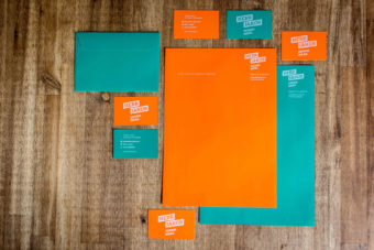 business cards, stationery and envelopes colorful design in orange and
