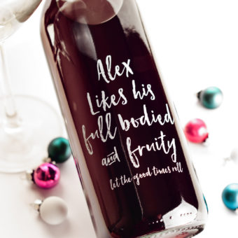 glass bottle with lettering in white