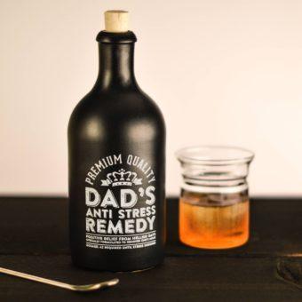 black bottle for gin with white toner printed lettering