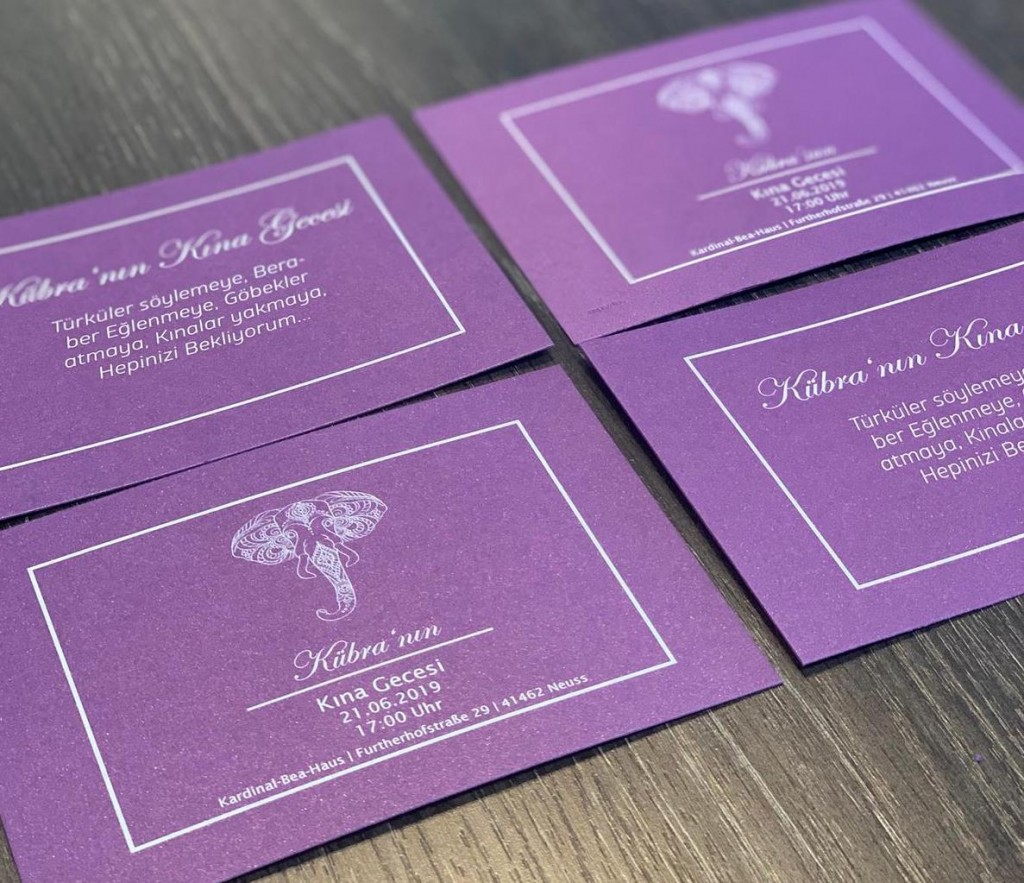 card invitation design with purple paper and white toner print