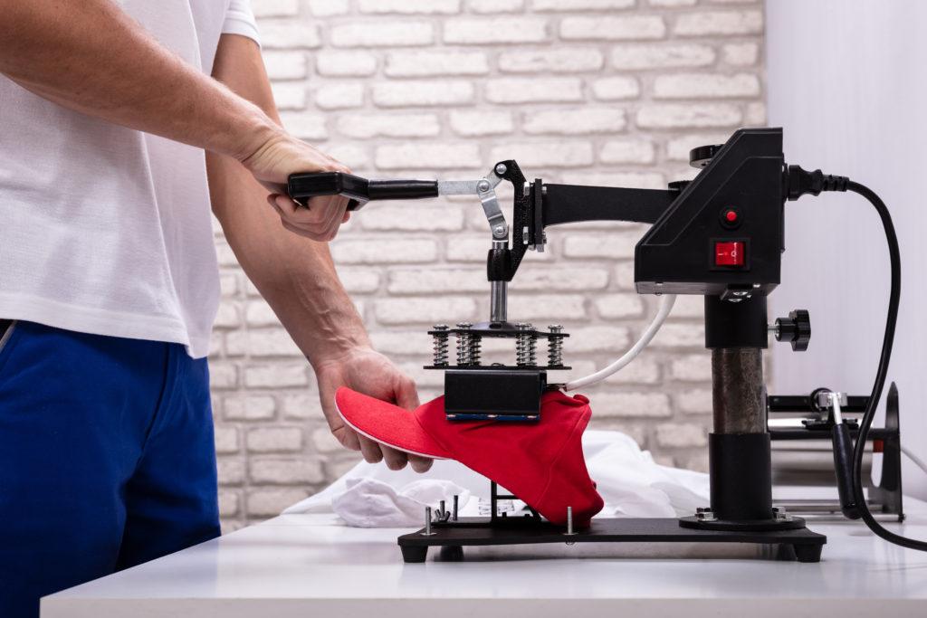 man printing cap